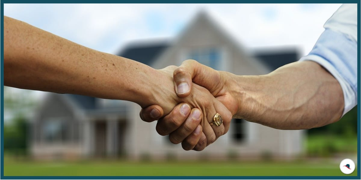 Immobilie verkaufen Handschlag
